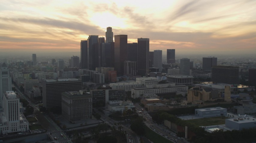 5K stock footage aerial video of Downtown Los Angeles skyline at sunset seen from east of the city, California Aerial Stock Footage | DCLA_032