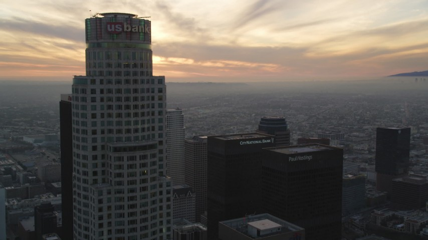 5K stock footage aerial video fly over Downtown Los Angeles by US Bank Tower to approach setting sun, California Aerial Stock Footage | DCLA_038