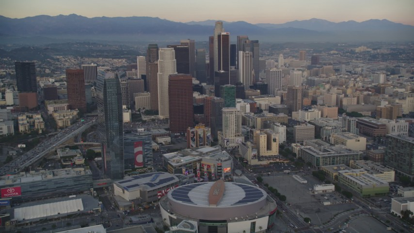 5K stock footage aerial video of Staples Center, The Ritz-Carlton and skyscrapers in Downtown Los Angeles at sunset, California Aerial Stock Footage | DCLA_040