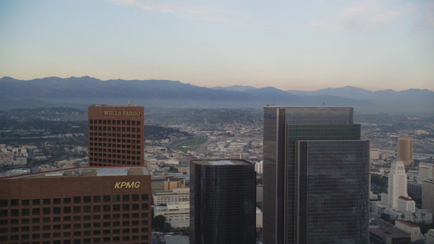 Fly Between Skyscrapers at Sunset in Downtown Los Angeles, California Aerial Stock Footage | DCLA_044