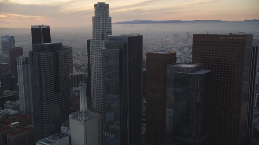 5K stock footage aerial video tilt to reveal and approach US Bank Tower at twilight in Downtown Los Angeles, California Aerial Stock Footage | DCLA_048