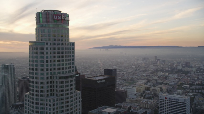 5K stock footage aerial video fly over high-rise to approach US Bank Tower at sunset in Downtown Los Angeles, California Aerial Stock Footage | DCLA_049