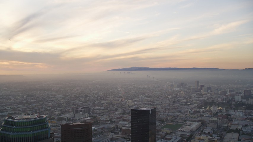 5K stock footage aerial video of Century City seen from Downtown Los Angeles at sunset, California Aerial Stock Footage | DCLA_050