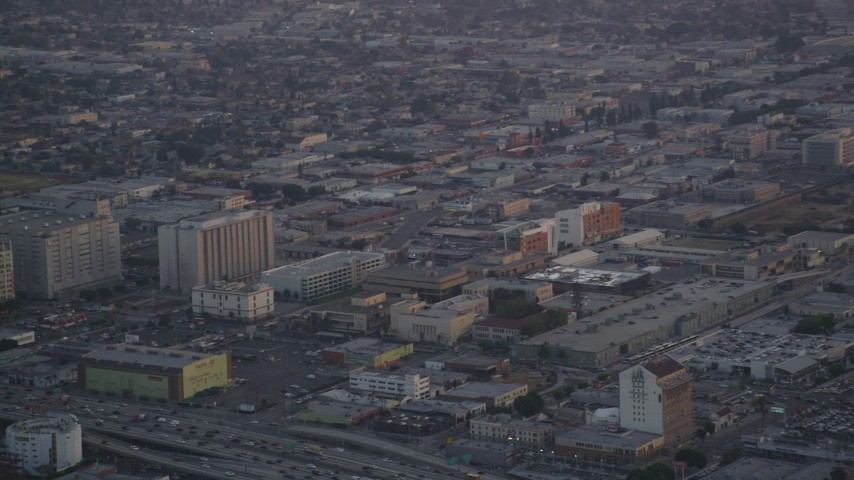 5K stock footage aerial video track a police helicopter flying over Downtown Los Angeles at twilight, California Aerial Stock Footage | DCLA_051