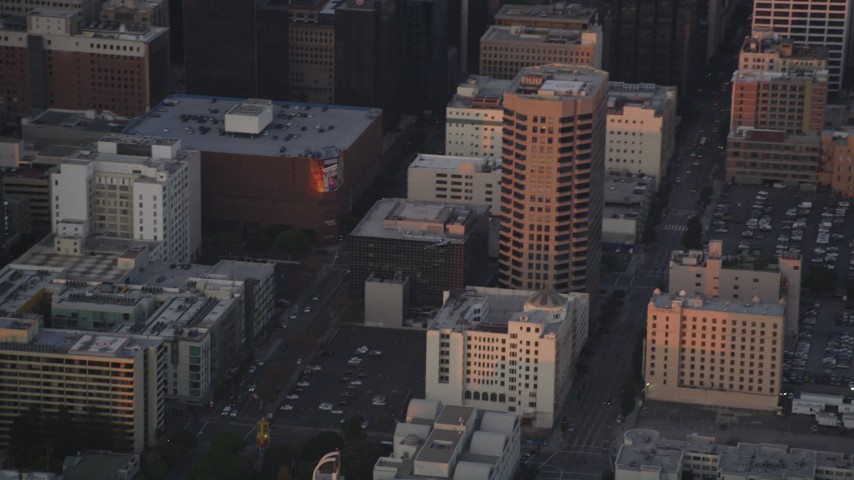 5K stock footage aerial video track police helicopter over Downtown Los Angeles office buildings at twilight, California Aerial Stock Footage | DCLA_054