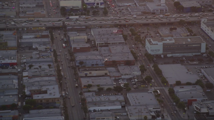 5K stock footage aerial video track police helicopter over city streets and buildings in Downtown Los Angeles at twilight, California Aerial Stock Footage | DCLA_057