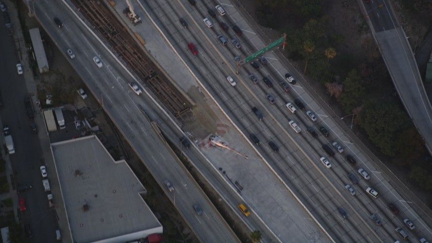 5K stock footage aerial video bird's eye view of tracking police helicopter over freeway at twilight in Downtown Los Angeles, California Aerial Stock Footage | DCLA_060