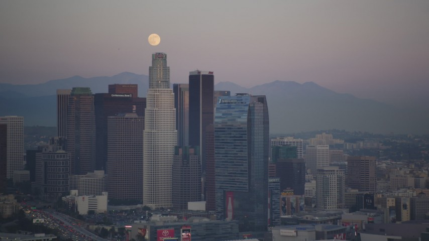 5K stock footage aerial video of full moon over Downtown Los Angeles skyscrapers at twilight, California Aerial Stock Footage | DCLA_062