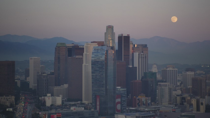 5K stock footage aerial video of full moon and Downtown Los Angeles skyscrapers at twilight, California Aerial Stock Footage | DCLA_063