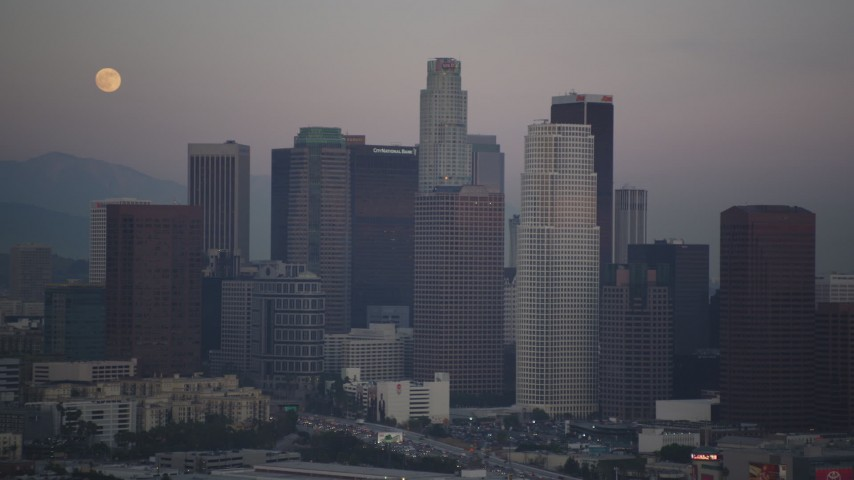 Downtown Los Angeles High-Rises with the Full Moon Overhead at twilight Aerial Stock Footage | DCLA_066