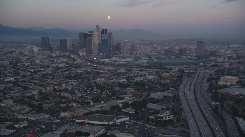 5K stock footage aerial video of moon over Downtown Los Angeles skyline seen from I-10 at twilight, California Aerial Stock Footage | DCLA_069
