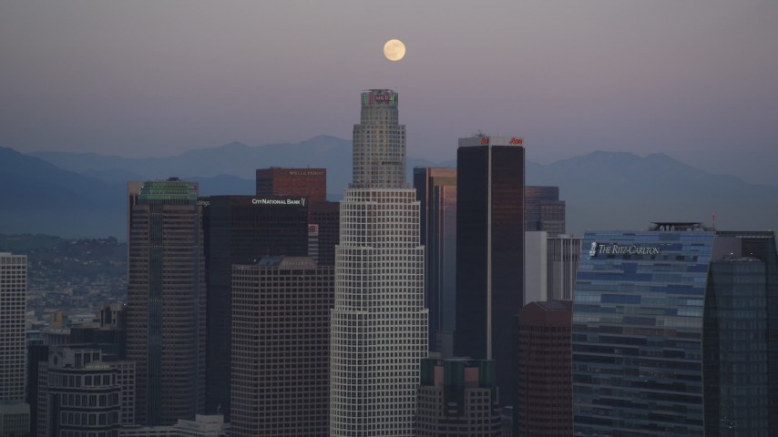 5K stock footage aerial video tilt from rush hour traffic on I-110 to reveal moon over Downtown Los Angeles at twilight, California Aerial Stock Footage | DCLA_071