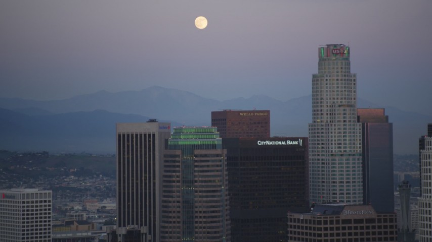 5K stock footage aerial video full moon seen while flying by Downtown Los Angeles at twilight, California Aerial Stock Footage | DCLA_074