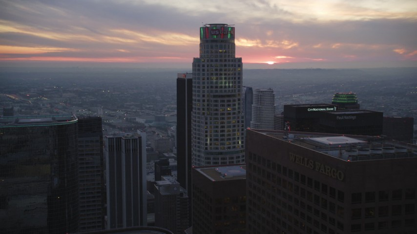 5K stock footage aerial video tilt from office buildings, reveal and approach US Bank Tower in Downtown Los Angeles at twilight, California Aerial Stock Footage | DCLA_076