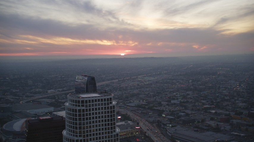 5K stock footage aerial video fly over Downtown Los Angeles as sun sets on horizon, California Aerial Stock Footage | DCLA_078