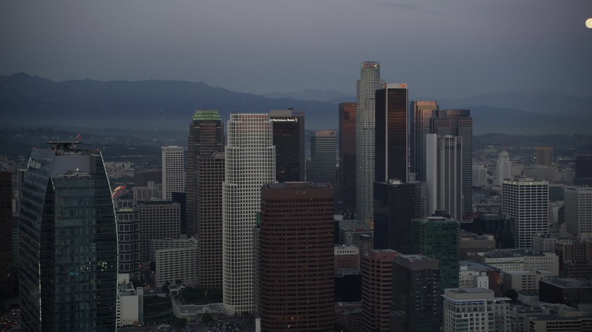 5K stock footage aerial video pass The Ritz-Carlton to reveal towers in Downtown Los Angeles at twilight, California Aerial Stock Footage | DCLA_079