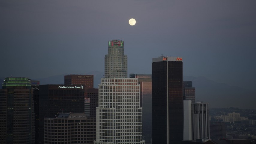 5K stock footage aerial video orbit The Ritz-Carlton to reveal Downtown Los Angeles towers and full moon at twilight, California Aerial Stock Footage | DCLA_080