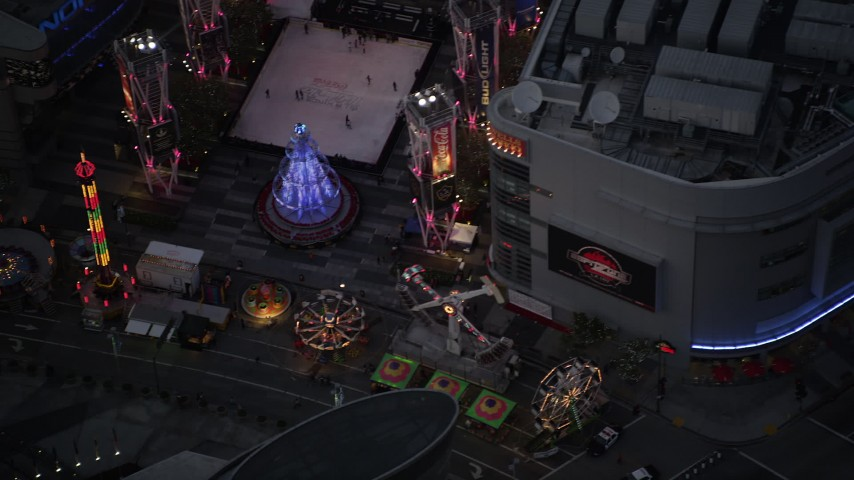 5K stock footage aerial video of a bird's eye view of a Christmas fair at Nokia Theater in Downtown Los Angeles at twilight, California Aerial Stock Footage | DCLA_082