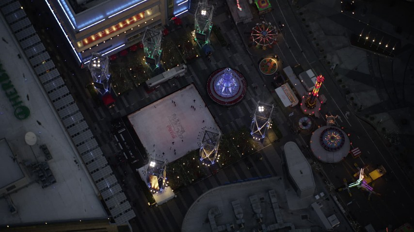 5K stock footage aerial video bird's eye orbit of ice skating rink and fair in Downtown Los Angeles at twilight, California Aerial Stock Footage | DCLA_083