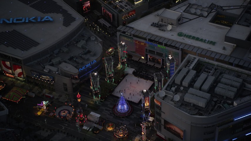 5K stock footage aerial video fly over ice skating and fair at Nokia Theater in Downtown Los Angeles at twilight, California Aerial Stock Footage | DCLA_084