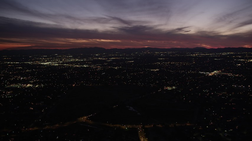 5K stock footage aerial video pan across suburban neighborhoods in the San Fernando Valley at twilight, California Aerial Stock Footage | DCLA_087