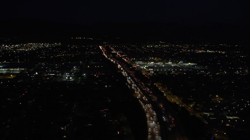 5K stock footage aerial video tilt from highway 118 to reveal and approach shopping center at night in Pacoima, California Aerial Stock Footage | DCLA_098