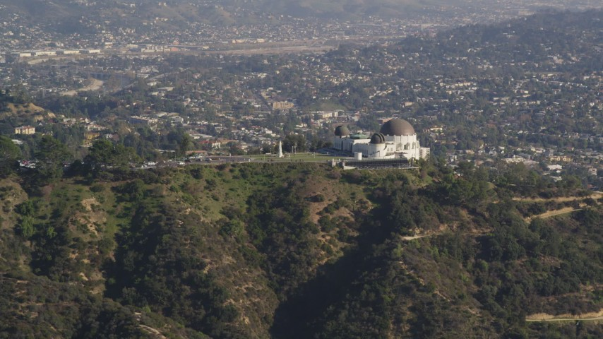 5K stock footage aerial video of Griffith Observatory overlooking Los Angeles Basin in California Aerial Stock Footage | DCLA_108