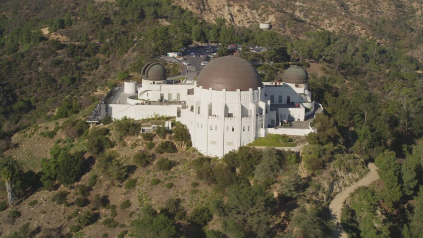 5K stock footage aerial video orbit the face of the hilltop Griffith Observatory in Los Angeles, California Aerial Stock Footage | DCLA_111