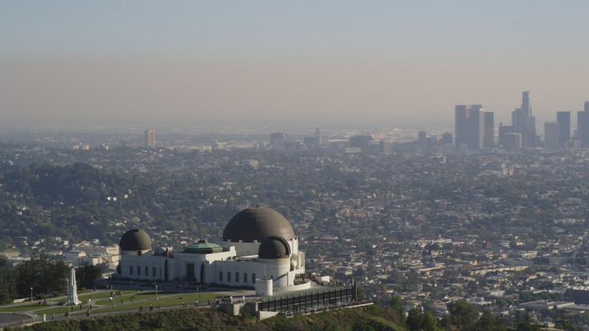 5K stock footage aerial video orbit Griffith Observatory to reveal Downtown Los Angeles skyline, California Aerial Stock Footage | DCLA_113