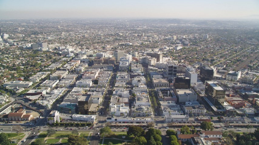 Tilt from Beverly Hills Mansions to Reveal Shops and Office Buildings by Santa Monica Boulevard Aerial Stock Footage | DCLA_118