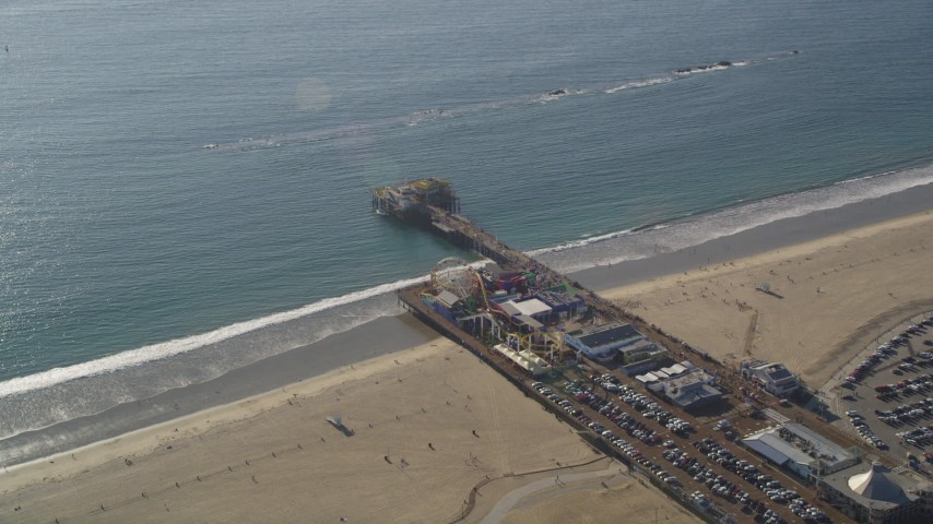 Orbiting Santa Monica Pier on the Beach in Los Angeles, California Aerial Stock Footage | DCLA_123