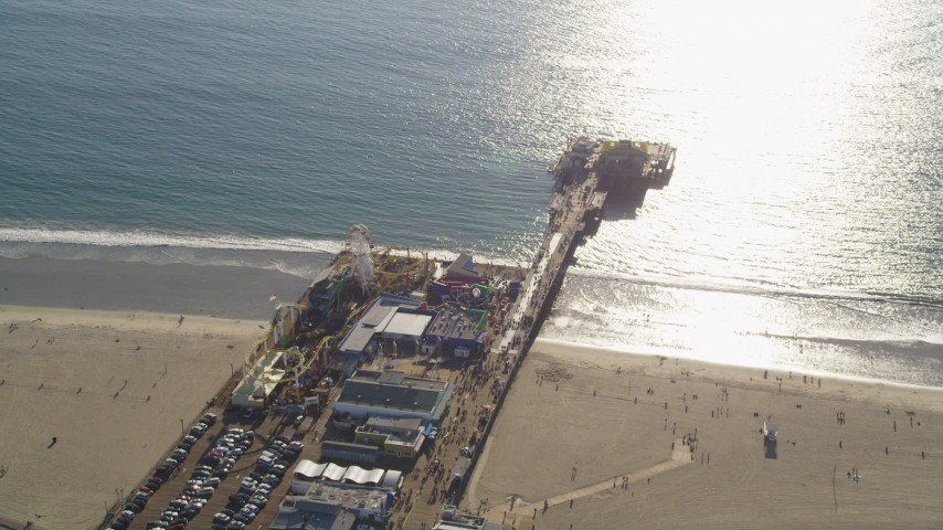 5K stock footage aerial video of orbiting Santa Monica Pier on the beach in Los Angeles, California Aerial Stock Footage | DCLA_123