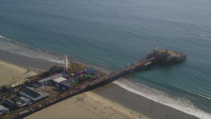 Orbit of the Santa Monica Pier in Los Angeles, California Aerial Stock Footage DCLA_124
