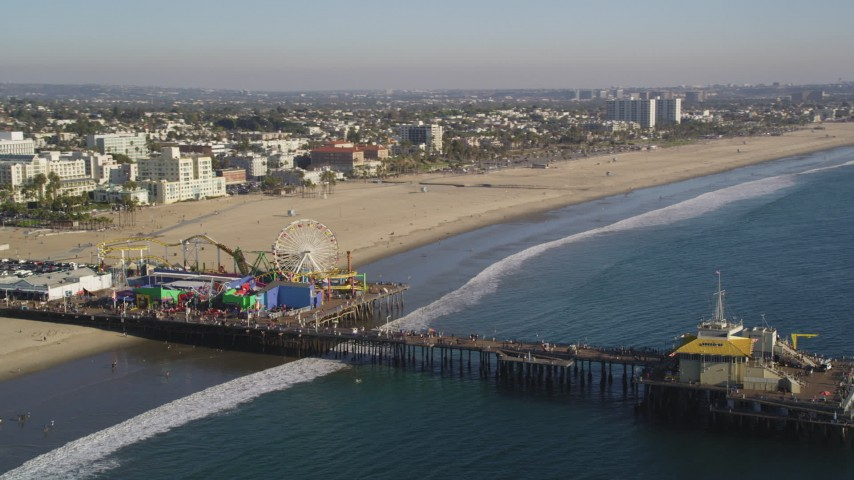 Orbit the Santa Monica Pier with Visitors in Los Angeles Aerial Stock Footage DCLA_125