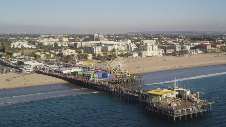 Orbit End of Santa Monica Pier with Visitors in Los Angeles Aerial Stock Footage | DCLA_126