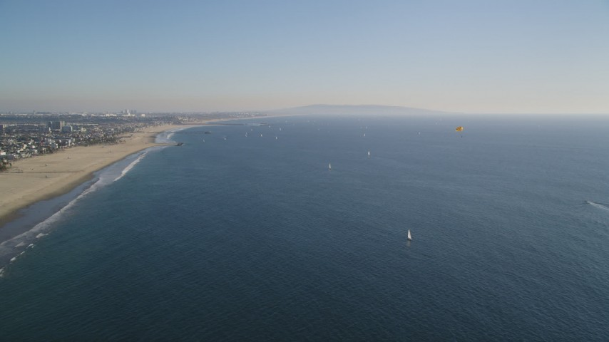 5K stock footage aerial video of sailboats and parasailers near the beach in Santa Monica, California Aerial Stock Footage | DCLA_128