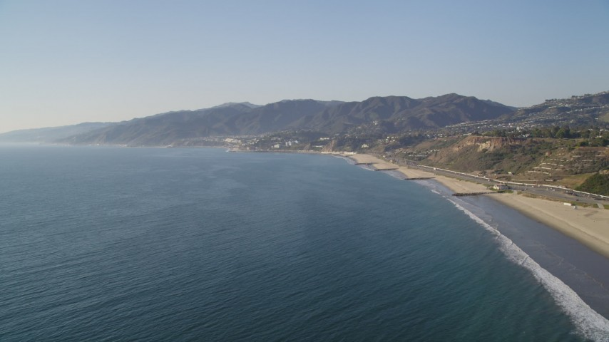 5K stock footage aerial video of beach in Pacific Palisades seen from the Pacific Ocean, California Aerial Stock Footage | DCLA_131