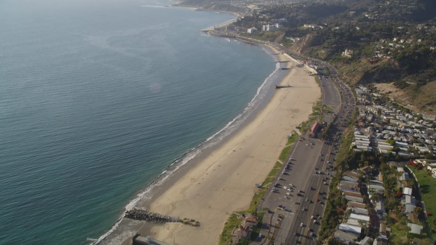Tilt from Bird's Eye View of Highway 1 and Beach by Pacific Palisades, California Aerial Stock Footage | DCLA_133