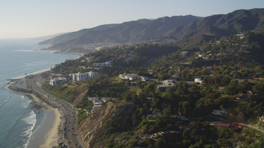 5K stock footage aerial video bird's eye view of Highway 1 and tilt to reveal hilltop homes in Pacific Palisades, California Aerial Stock Footage | DCLA_134