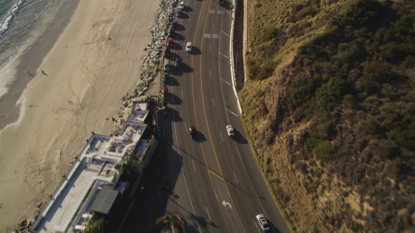 Tilt from Highway 1 and Beach to Malibu, CA Aerial Stock Footage | DCLA_139