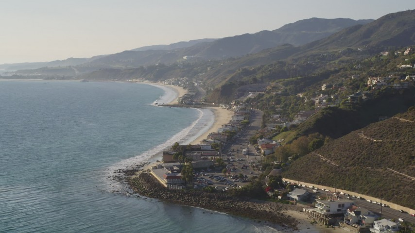 5K stock footage aerial video tilt from ocean to reveal the coastal community of Malibu, California Aerial Stock Footage | DCLA_145