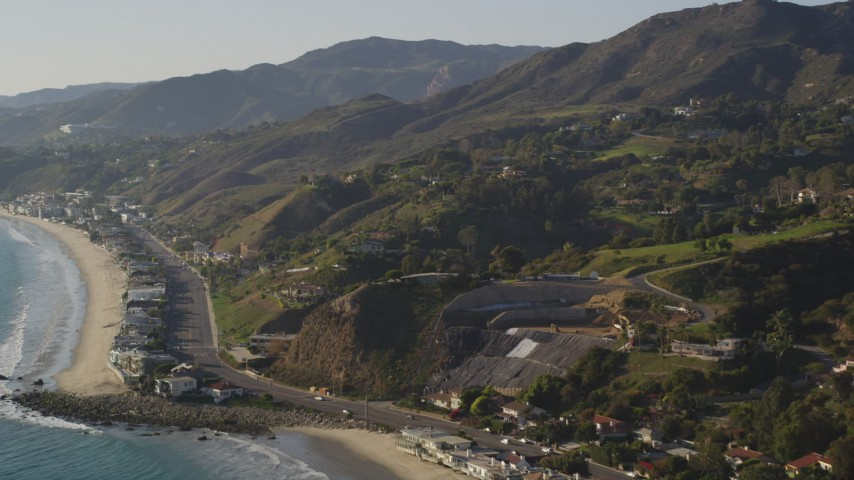 Pan from Coastal Foothills to Beachfront Homes in Malibu Aerial Stock Footage | DCLA_146