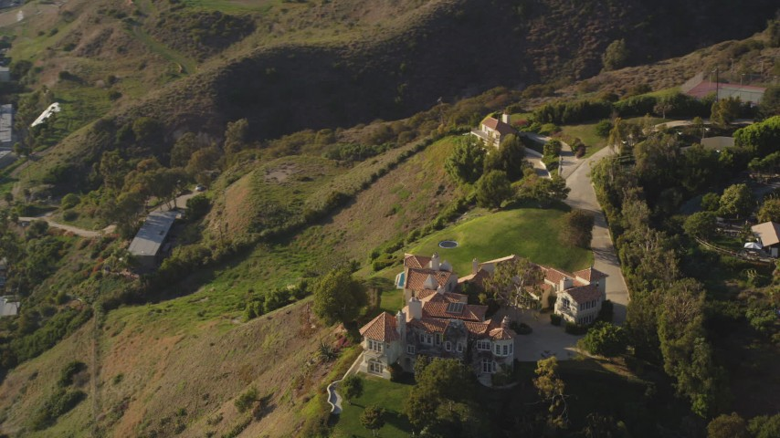 Orbit Hilltop Mansion to Reveal Beachfront Homes in Malibu Aerial Stock Footage | DCLA_152