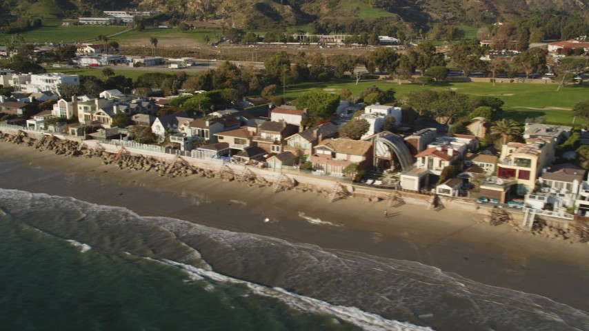 Pan Across Beachfront Homes in Malibu, California Aerial Stock Footage | DCLA_153
