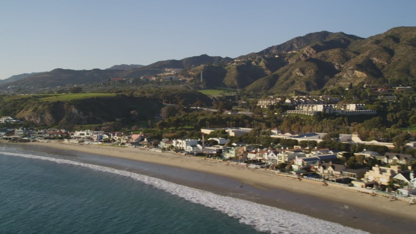 5K stock footage aerial video pan across beachfront homes in Malibu, California Aerial Stock Footage | DCLA_153