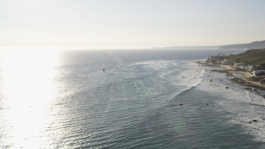 Tilt from Ocean to Reveal Oceanfront Homes in Malibu, California Aerial Stock Footage | DCLA_154