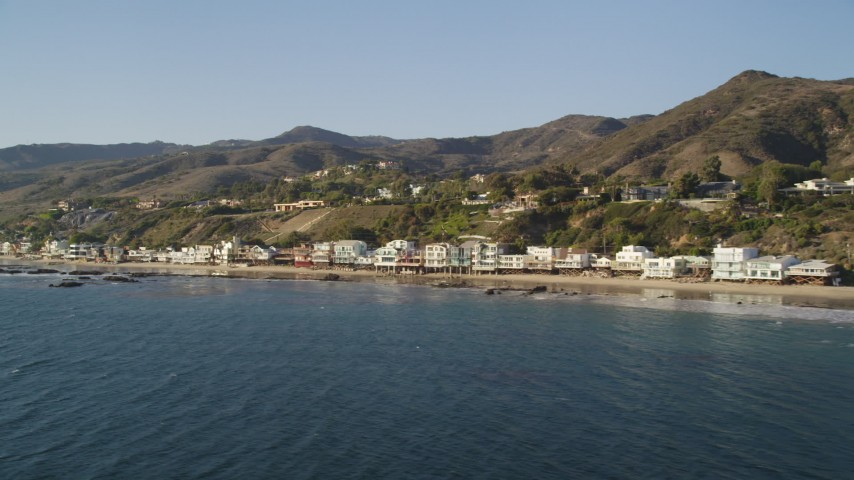 Fly Low by Beachfront Homes in Malibu, California Aerial Stock Footage | DCLA_156