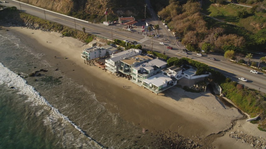 5K stock footage aerial video approach beachfront homes and Highway 1 in Malibu, California Aerial Stock Footage | DCLA_161