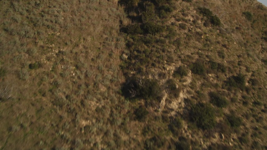 Fly Over Mountains to Reveal and Approach Highway 1 on the Coast in Malibu Aerial Stock Footage   DCLA_166