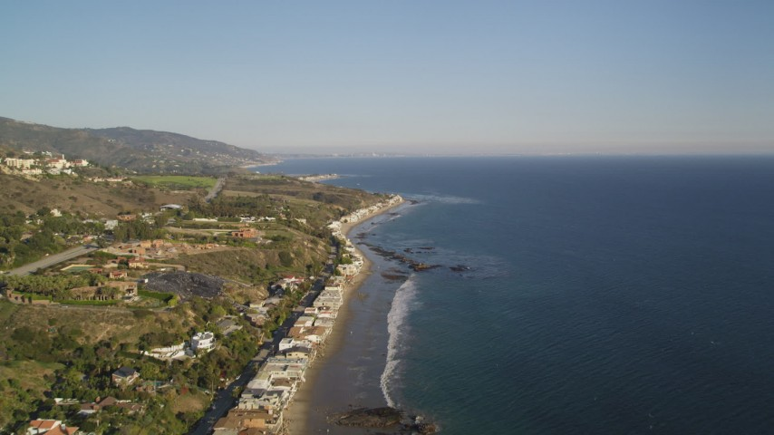 Fly Over Highway 1 and Homes on the Beach in Malibu, California Aerial Stock Footage | DCLA_167